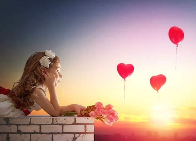 Little Girl Dreaming with Heart Balloons